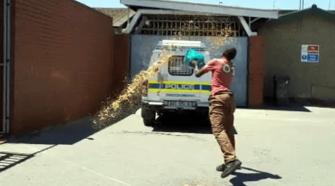 man has thrown poo at a police van