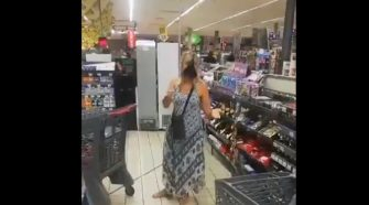 woman takes off her panty and uses it as mask inside the store