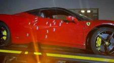 Police markers point to the bullets fired into a Ferrari